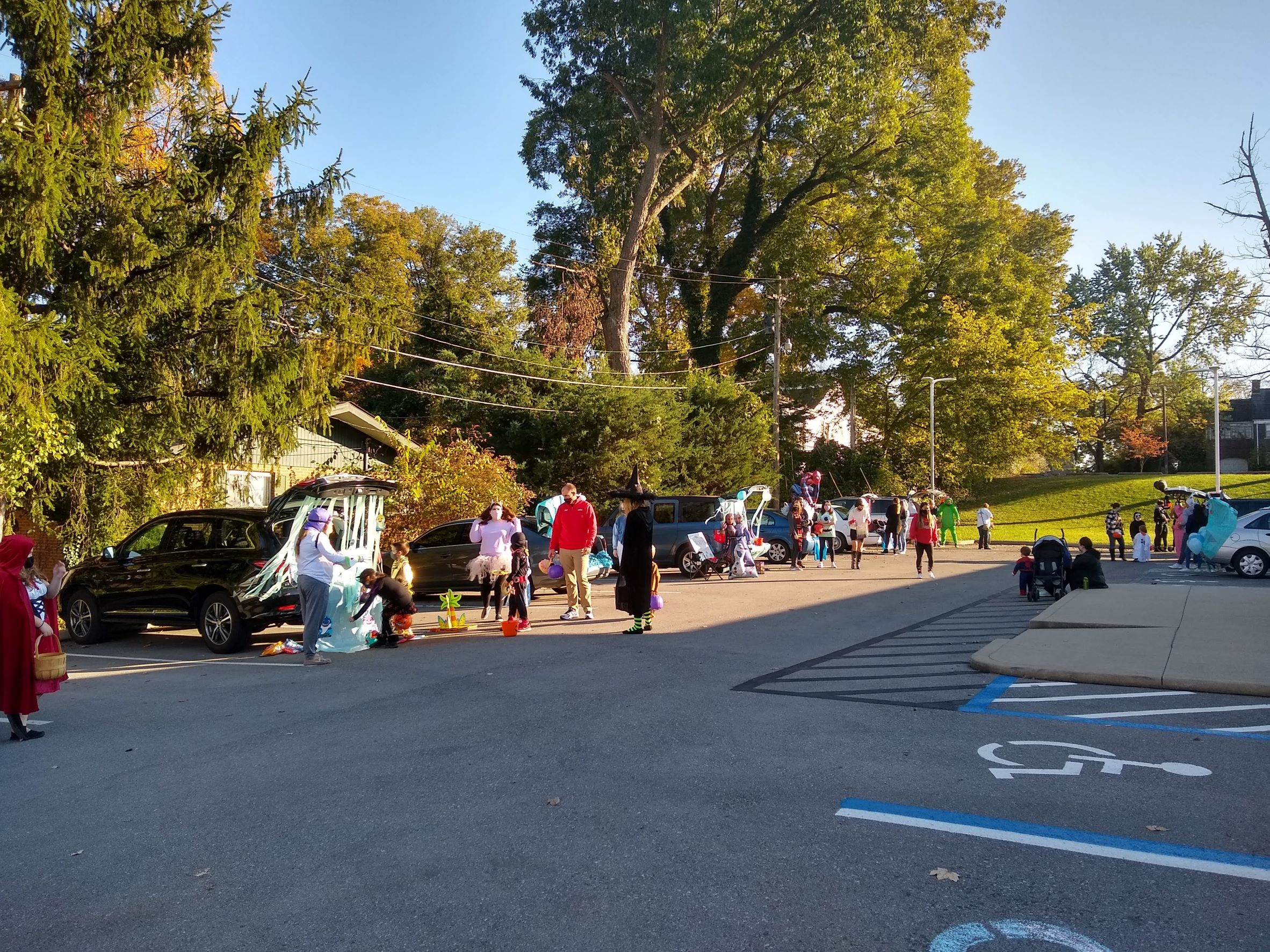 A view of the parking lot with cars decorated for the Trunk or Treat